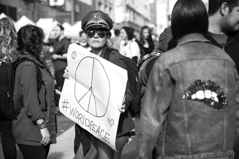 protester-peace-sign-black-white