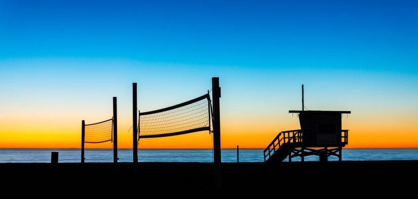 sunset-gradient-sky-lifeguard-tower-volleyball-court